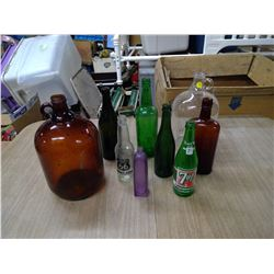LOT OF RED BOTTLES AND GLASS JUGS