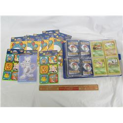 Lot of Pokemon articles book with cards and 11 sealed Sticker Packs