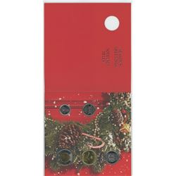 2013 5-piece Christmas set that includes Holly Wreath 25 cents.