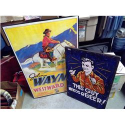 "John Wayne poster in frame, ""This Guy Needs a Beer"" painted on canvas"