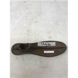 A RUSTY SHOEMAKERS TOOL