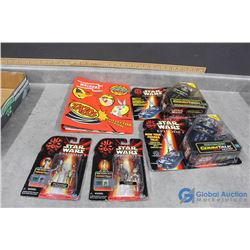 Star Wars Toy in Packages and Star Wars Tazos in Binder