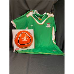 Green Zambia Sports Jersey and Orange Soccer Ball