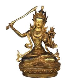 A GILT BRONZE MANJUSRI BUDDHA FIGURE QING DYNASTY.