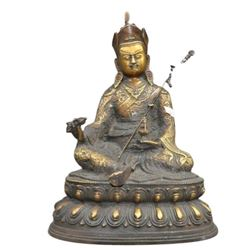 A GILT BRONZE RINPOCHE BUDDHA FIGURE QING DYNASTY.
