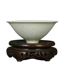 A DING WHITE MELON SHAPE BOWL QING DYNASTY.