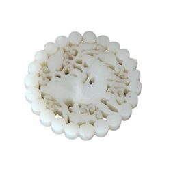 A WHITE JADE BEAST PENDANT QING DYNASTY.
