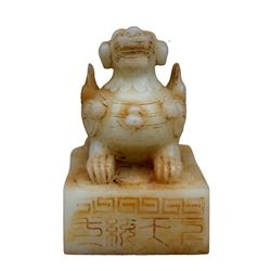 A NATURAL WHITE JADE BEAST SEAL QING DYNASTY.