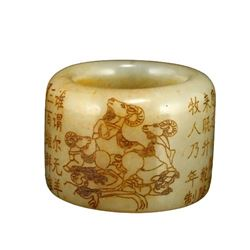 A NATURAL HETIAN JADE CARVED CALLOGRAPHY RING QING DYNASTY.