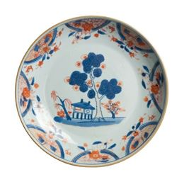 A BLUE AND RED LANDSCAPE PLATE KANGXI PERIOD.