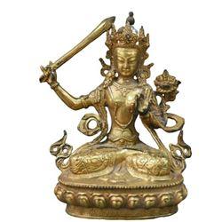 A GILT BRONZE MANJUSHRI BUDDHA FIGURE QING DYNASTY.