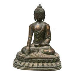 A BRONZE SHAKYAMUNI BUDDHA FIGURE QING DYNASTY.