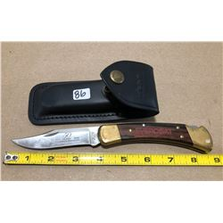 BUCK KNIFE W/ LEATHER SHEATH - 2003 EVERCOAT