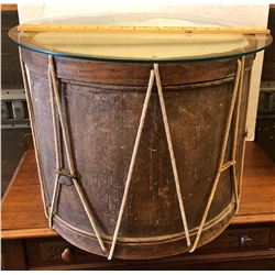 ANTIQUE DRUM WITH GLASS TOP CREATING A SIDE TABLE