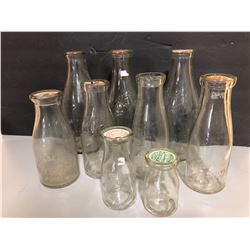 LOT OF 9 ANTIQUE EMBOSSED MILK BOTTLES