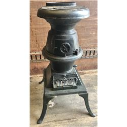CAST DECORATIVE WOOD STOVE