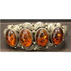 Amber 4 stone bracelet by Clem Nalwood, Navajo