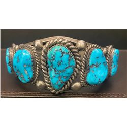 Heavy Morenci Turquoise Bracelet Sterling 1960's 7 nuggets