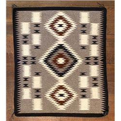 Navajo Weaving by Maybelle Many Mules