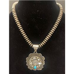 A Navajo Pearl Silver Beaded Necklace and Pendant