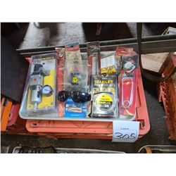 Lot of new in package items, pliers, tape measure, filter regulator