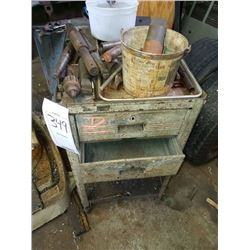 Metal cart on wheels and assorted drill parts
