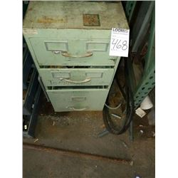 Filing cabinet with drill bits