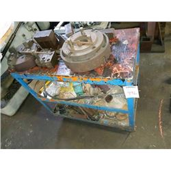 Blue cart with assorted lathe parts and heads