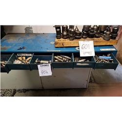 Blue shelf cabinet with assorted drill bits and heads
