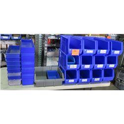 Multiple Empty Blue Plastic Storage Stackable Bins