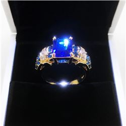Ladies 6K Tanzanite Stone Ring, Mounted On Gold Tone Band With Inset Semi-Precious Stones