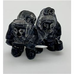Pair of hand painted Inuit Statues