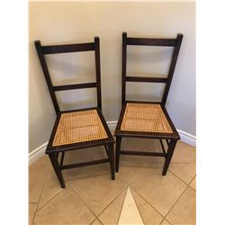 2 wood and wicker chairs