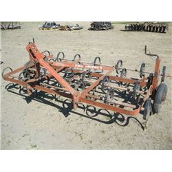 THE TRIPLE K SPRING TOOTH CULTIVATOR