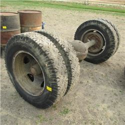 AXLE WITH DUAL WHEELS  750-20 TIRES