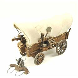 Completely Handmade and hand carved Conestoga  wagon by artist and not mass produced.  Estimated 50-