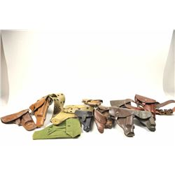 Large lot of European military holsters from  WWII to the Cold war era, some with belts, 2  magazine