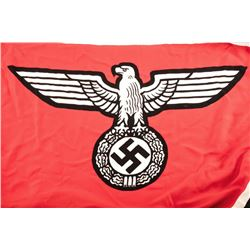 World War II era Nazi marked naval flag.  The  flag is approximately 12' x 6' with the  German eagle
