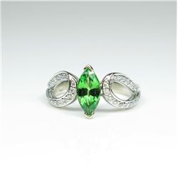 Lovely Contemporary Style Tsavorite Garnet  and Diamond Ring featuring a Marquise cut  Tsavorite wei