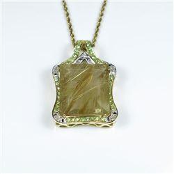 Incredible Huge Rutile Quartz, Tsavorite and  Diamond Pendant featuring an emerald cut  Rutile Quart