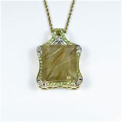Incredible Huge Rutile Quartz, Tsavorite and  Diamond Pendant featuring an emerald cut  Rutile Quart