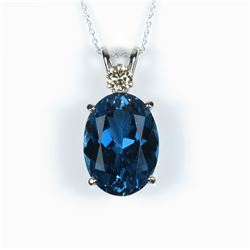 Gorgeous pendant featuring a large London  Blue Topaz weighing 16.50 carats with an  ��IDEAL�� cut Dia