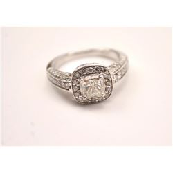One 18 k white gold ring set with a 1.02ct  radiant cut diamond surrounded by 58 diamonds  weighing