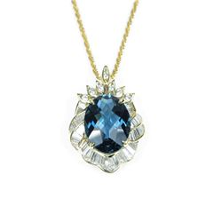 Dazzling Fine London Blue Topaz and Diamond  Pendant featuring an oval checkerboard cut  Topaz weigh