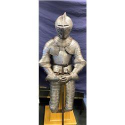 Authentic three-quarter suit of armor with  closed helmet showing Alsatian crest with  minor restora