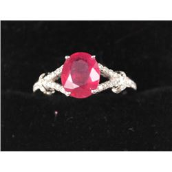 One beautifully designed ruby diamond ring  made in 18k white gold containing 2,25ct oval  ruby and