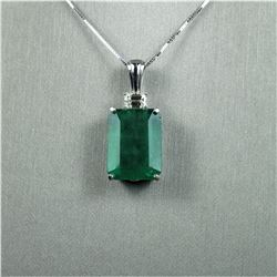 Magnificent 22.67 carat GIA Certified Natural  Emerald perfectly accented with a 0.72 carat  emerald
