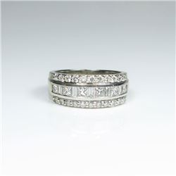 Brilliant 'KALLATI' Designer Diamond Ring  featuring 33 channel set Princess, baguette  and round cu