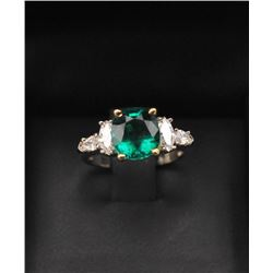 One magnificent custom designed ring set with  a 2.65ct Colombian emerald set in 18k yellow  gold he
