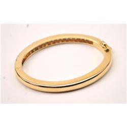 One beautifully made solid gold hinged bangle  bracelet weighing 31 gms and pave set with  4ct of G-